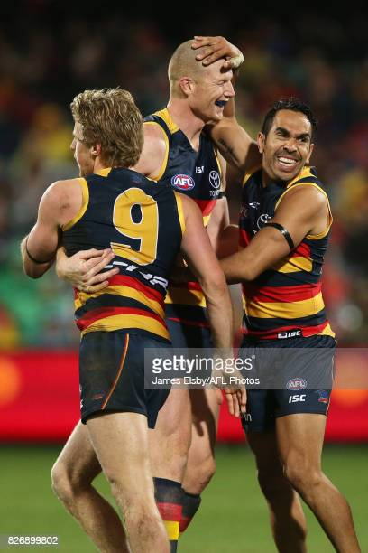 Rory Sloane Sam Jacobs and Eddie Betts of the Crows celebrates a goal during the 2017 AFL round 20 match between the Adelaide Crows and the Port...