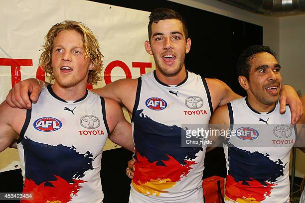 Rory Sloane Taylor Walker and Eddie Betts sing the team song after winning during the round 20 AFL match between the Brisbane Lions and the Adelaide...
