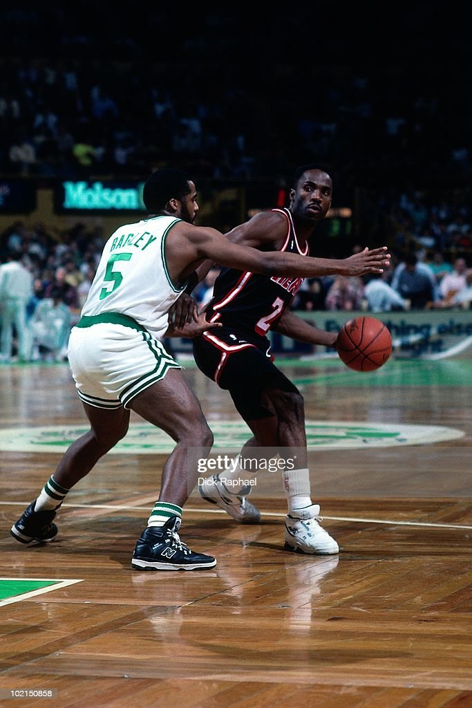 Rory Sparrow #2 of the Miami Heat looks to make a move against John Bagley #5 of the Boston Celtics during a game played in 1990 at the Boston Garden in Boston, Massachusetts.