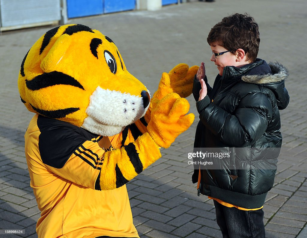 Rory the Hull mascot greets a young fan outside the KC Stadium prior the FA Cup with Budweiser Third Round match between Hull City and Leyton Orient at the KC Stadium on January 5, 2013 in Hull, England.