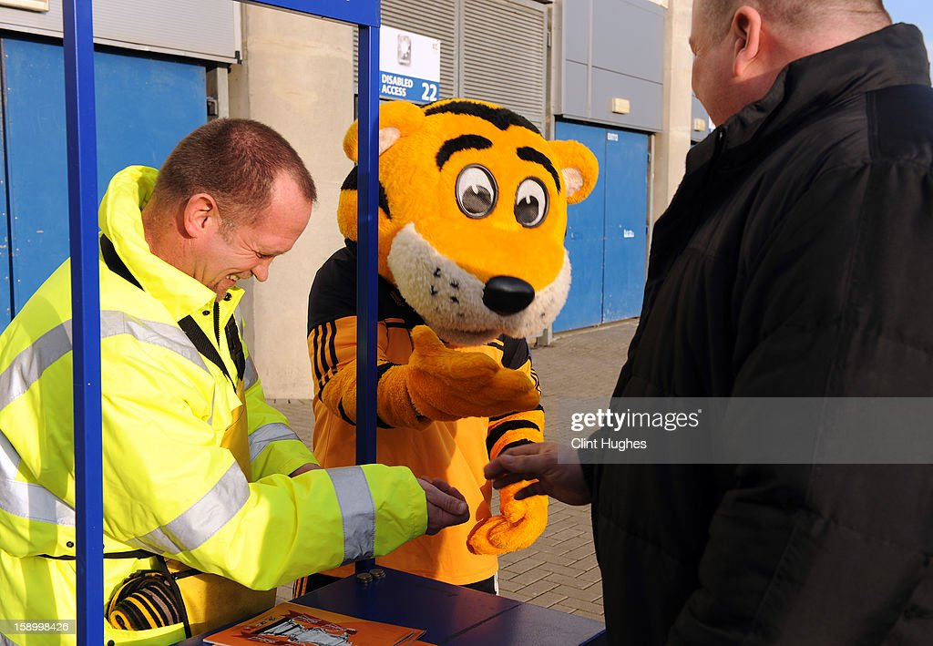 Rory the Hull mascot (C) helps to sell match day programmes outside the KC Stadium prior the FA Cup with Budweiser Third Round match between Hull City and Leyton Orient at the KC Stadium on January 5, 2013 in Hull, England.