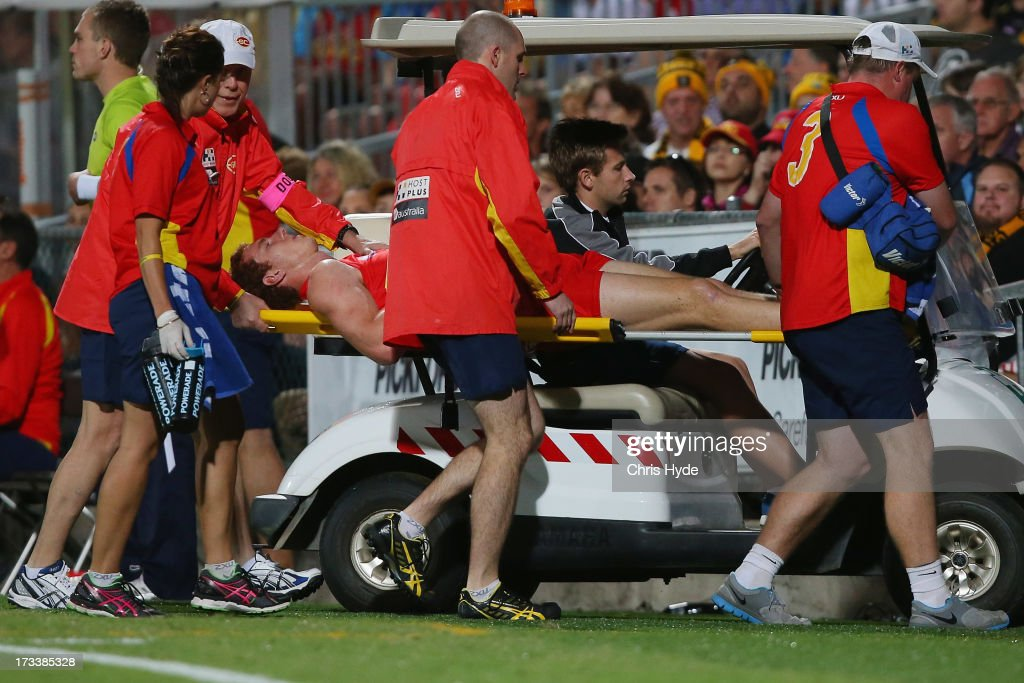 Rory Thompson of the Suns is taken from the field injured during the round 16 AFL match between the Richmond Tigers and the Gold Coast Suns at Cazaly's Stadium on July 13, 2013 in Cairns, Australia.