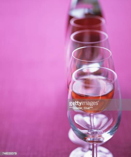 Ros wine glasses in a row