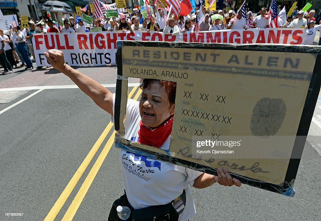 Rosa Araujo participates with thousands of people in the May Day march and rally on May 1, 2013 in Los Angeles, California. Labor organizations and immigration groups used the annual celebration to push for an immigration system overhaul.