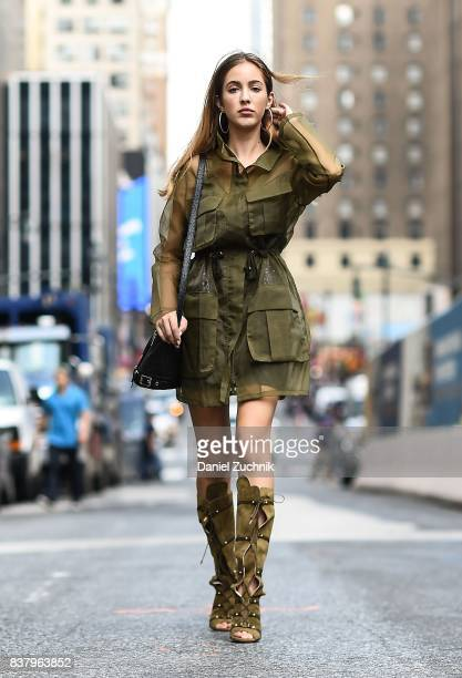 Rosa Crespo is seen in midtown wearing a green outfit with boots on August 22 2017 in New York City