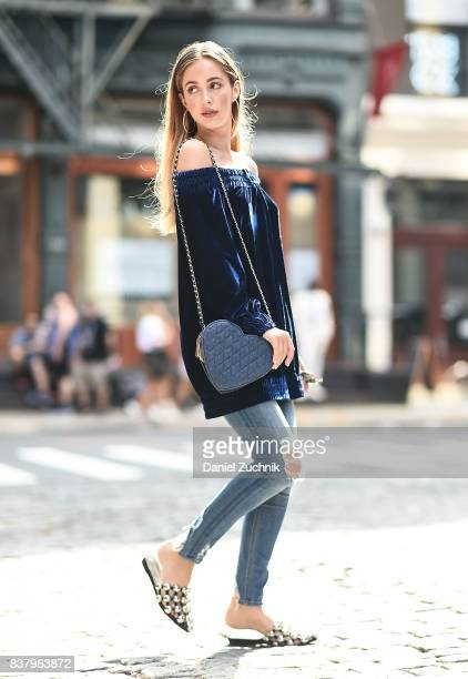 Rosa Crespo is seen in Soho wearing an Alexandrino blue top Tularosa jeans and Molly Bracken bag on August 22 2017 in New York City