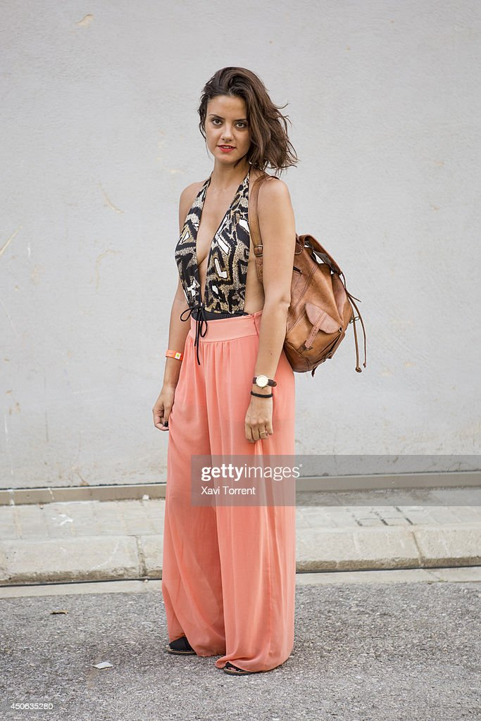 Rosa is wearing pants from American Apparel, a vintage trikini, sandals from Menorkina and a vintage bag at the Sonar Music Festival on June 14, 2014 in Barcelona, Spain.