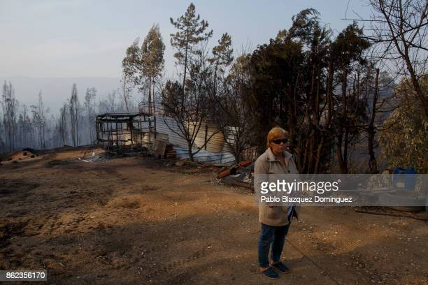 Rosa Madeira stands next to her burnt caravan in the village of Sao Pedro de Alva near Penacova on October 17 2017 in Coimbra region Portugal At...