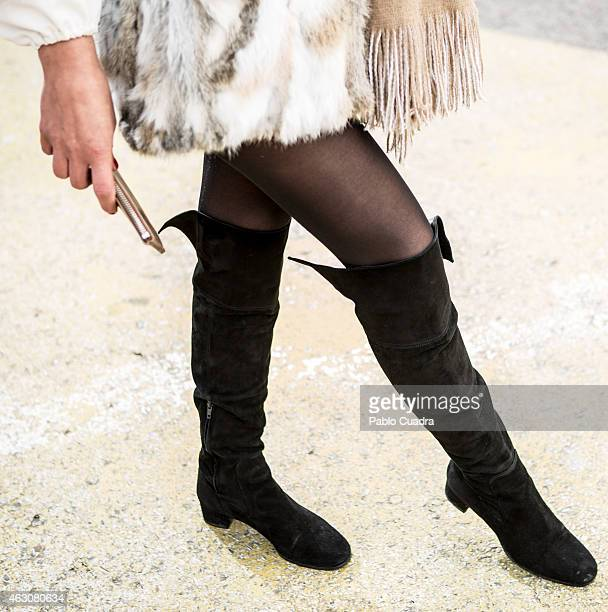 Rosa Maria wears Zara boots and scarf Easy wear coat and BimbaLola handbag during Mercedes Benz Madrid Fashion Week Fall/Winter 2015/16 at Ifema on...