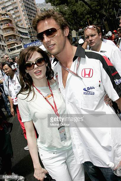 Rosa Mcgowan poses with BAR Honda driver Jenson Button before the start of the Monaco Grand Prix on May 22 2005 in Cannes France