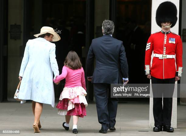 Rosa Monckton friend of Diana left and her husband Dominic Lawson right with their daughter Domenica Diana's god daughter at the Service of...