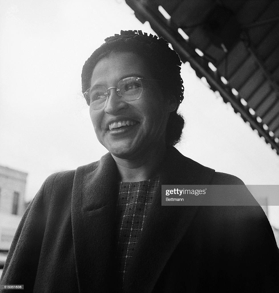 Rosa Parks smiling after a Supreme Court ruling banning segregation on city public transit vehicles took effect.