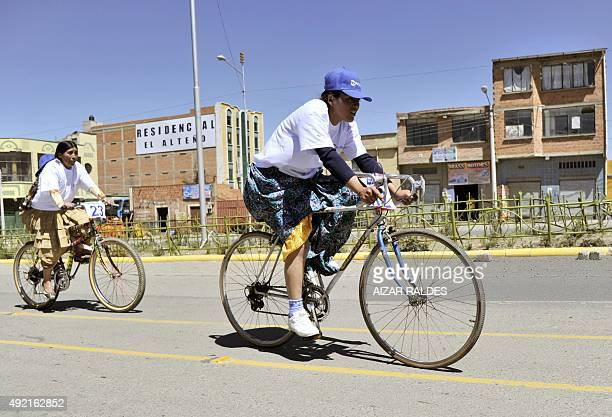 Rosa Ticona and others Aymaran native women take part in the 'Cholitas cycling race' celebrating the day of Bolivian woman on October 10 in El Alto...