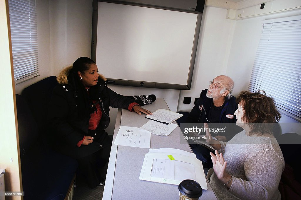 Rosa Velez (R) and her husband Samuel (2nd R) get assistance from a representative of New York State Department of Financial Services Foreclosure Relief Unit on February 9, 2012 in Islip, New York. The mobile van provides individuals who are facing foreclosure with counselors who can assess where homeowners are in the pre-foreclosure or foreclosure process. The mobile unit, which is equipped with computers and communications, looks to slow the number of foreclosures in the state and to provide information about loan modifications available to homeowners under federal law. Islip, which is located in Suffolk County, has the highest foreclosure rate in New York State.