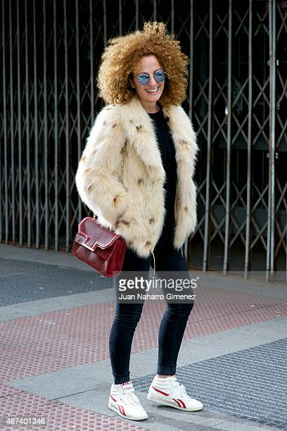 Rosa wears Reebok trainers Zara trousers sweater and hanbag Piedad de Diego jacket Aristocrazy ring and Ray Ban glases on March 23 2015 in Madrid...