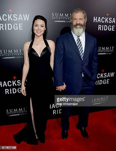 Rosalind Ross and director Mel Gibson attend the screening of Summit Entertainment's 'Hacksaw Ridge' at Samuel Goldwyn Theater on October 24 2016 in...