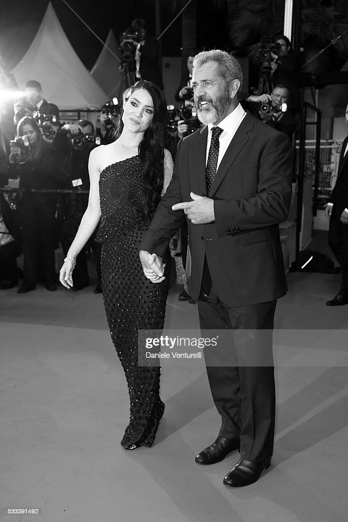 Rosalind Ross and Mel Gibson attend the screening of 'Blood Father' at the annual 69th Cannes Film Festival at Palais des Festivals on May 21 2016 in...