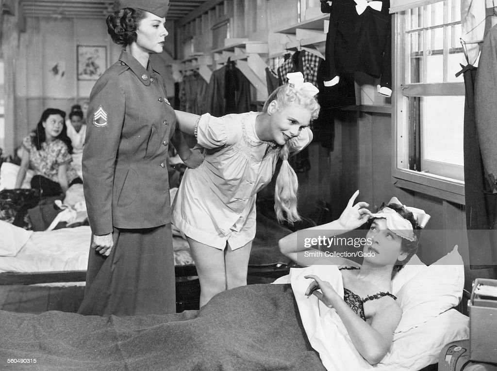 <a gi-track='captionPersonalityLinkClicked' href=/galleries/search?phrase=Rosalind+Russell&family=editorial&specificpeople=206523 ng-click='$event.stopPropagation()'>Rosalind Russell</a> and Marie Wilson in an army barracks, in a scene from the film 'Never Wave at a WAC,' 1953.