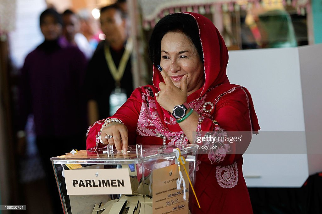 Rosamah Mansor, the wife of Malaysia's Prime Minister and Barisan Nasional (BN) chairman Najib Razak, casts her vote a polling station during election day on May 5, 2013 in Pekan, Malaysia. Millions of Malaysians casted their vote on Sunday in one of the most tightly contested Malaysian election since independence in 1957. The opposition coalition, Pakatan Rakyat (PeopleÕs Alliance), led by former deputy prime minister Anwar Ibrahim is seeking to gain power on a national level against the ruling party Barisan Nasional.