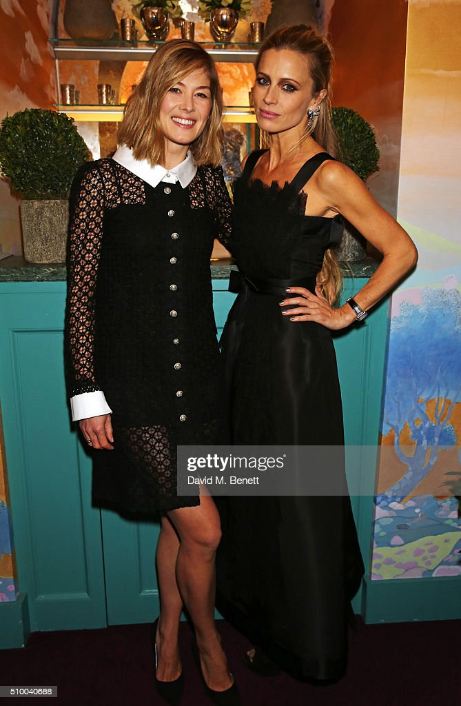 Rosamund Pike (L) and Laura Bailey attend the Charles Finch and Chanel Pre-BAFTA cocktail party and dinner at Annabel's on February 13, 2016 in London, England.