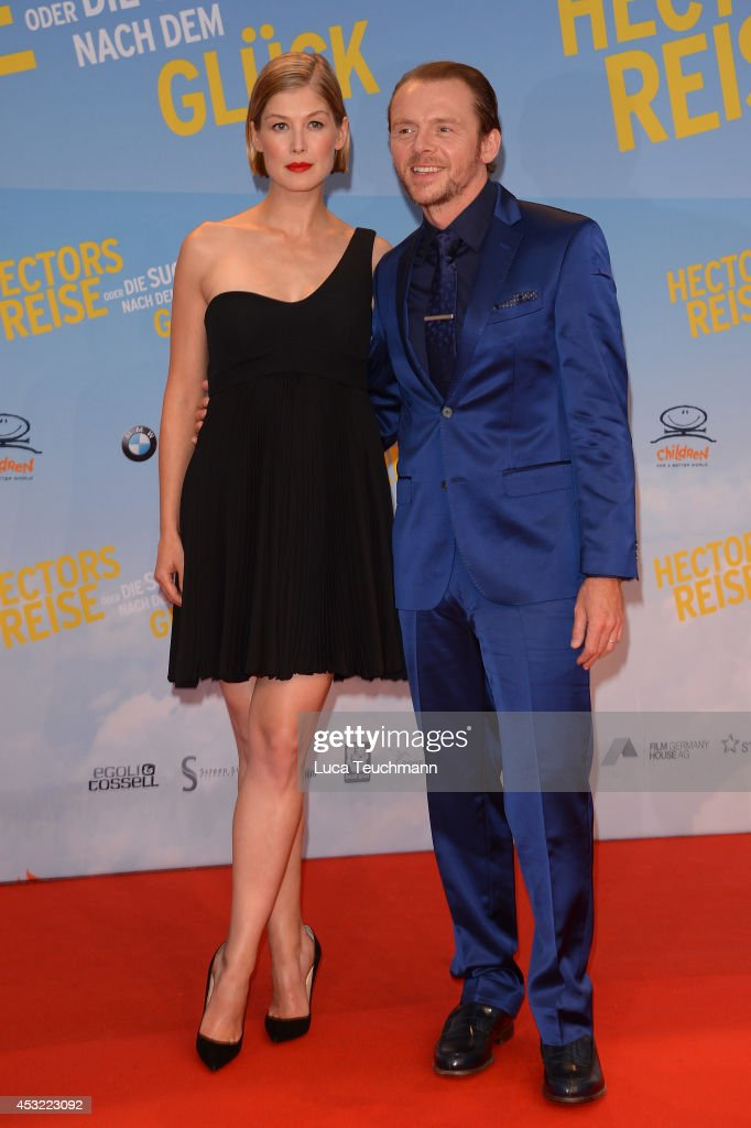 Rosamund Pike and Simon Pegg attend the premiere of the film 'Hector and the Search for Happiness' (German title: 'Hectors Reise') at Zoo Palast on August 5, 2014 in Berlin, Germany.