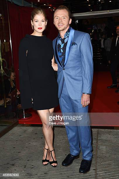 Rosamund Pike and Simon Pegg attend the UK premiere of 'Hector And The Search For Happiness' at The Empire Leicester Square on August 13 2014 in...