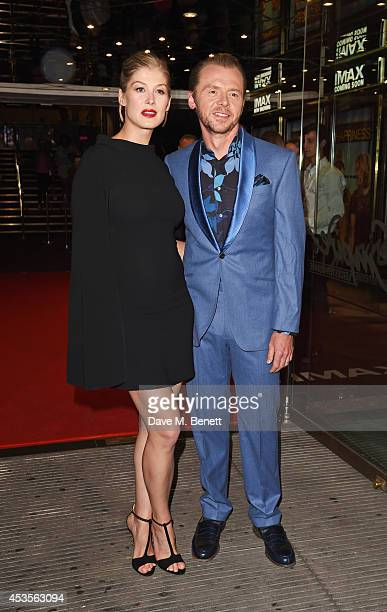 Rosamund Pike and Simon Pegg attend the UK Premiere of 'Hector And The Search For Happiness' at Empire Leicester Square on August 13 2014 in London...