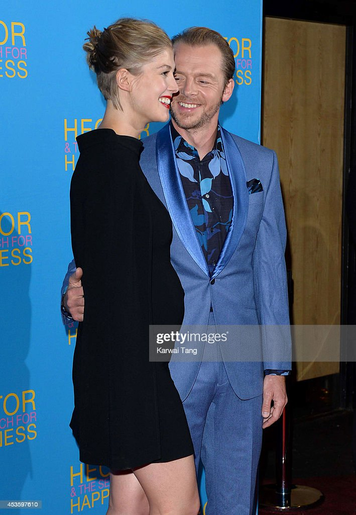 Rosamund Pike and Simon Pegg attend the UK Premiere of 'Hector And The Search For Happiness' at Empire Leicester Square on August 13, 2014 in London, England.