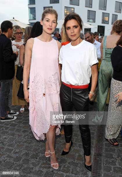Rosamund Pike and Victoria Beckham attend British Vogue editor Alexandra Shulman's leaving party at Dock Kitchen on June 22 2017 in London England