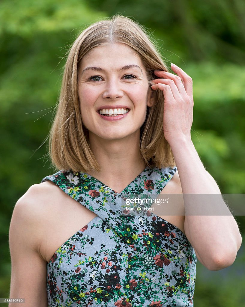 Rosamund Pike attends Chelsea Flower Show press day at Royal Hospital Chelsea on May 23, 2016 in London, England. The prestigious gardening show features hundreds of stands and exhibition gardens.