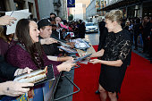 Rosamund Pike greets fans as she attends the World Premiere of 'What We Did On Our Holiday' at Odeon West End on September 22 2014 in London England