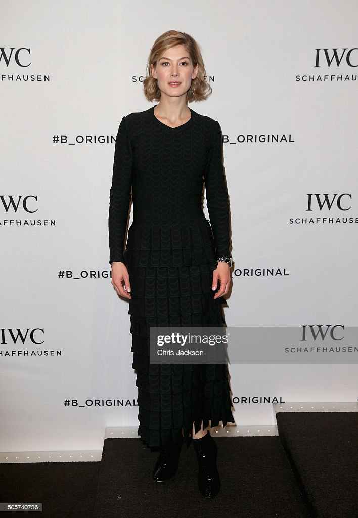 Rosamund Pike visits the IWC booth during the launch of the Pilot's Watches Novelties from the Swiss luxury watch manufacturer IWC Schaffhausen at the Salon International de la Haute Horlogerie (SIHH) 2016 on January 19, 2016 in Geneva, Switzerland.