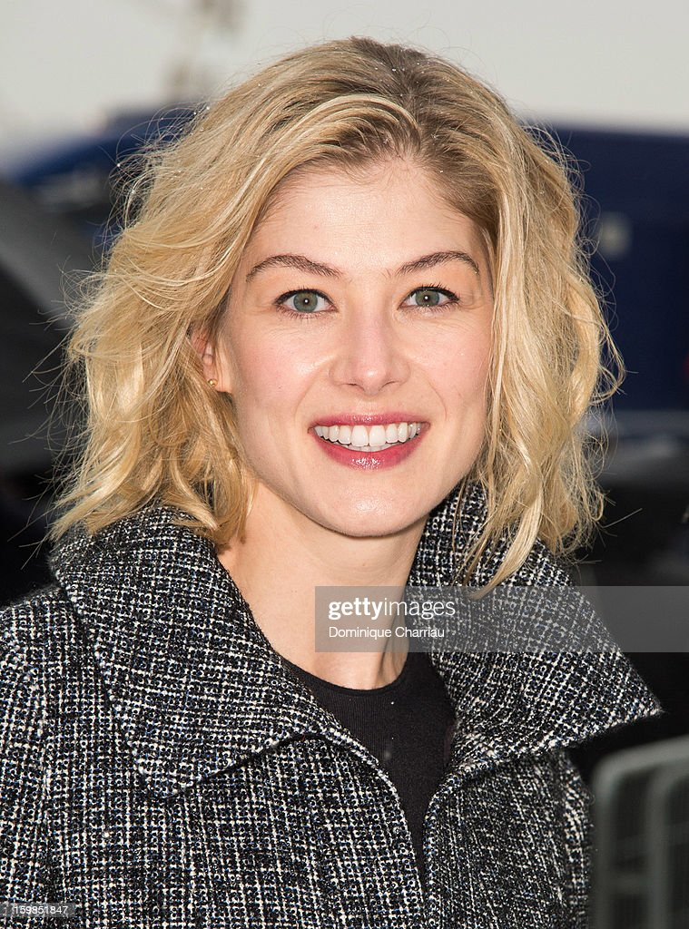 Rosamund Pyke attends the Christian Dior Spring/Summer 2013 Haute-Couture show as part of Paris Fashion Week at on January 21, 2013 in Paris, France.