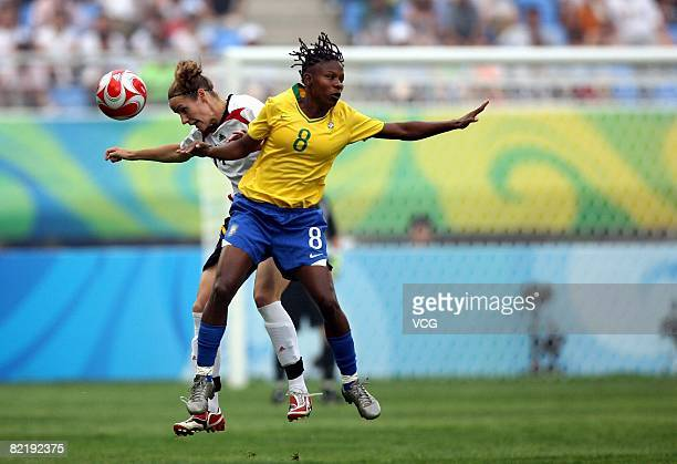 Rosana of Brazil fights for the ball with Melanie Behringer of Germany during the women's preliminary group F match between Germany and Brazil at...
