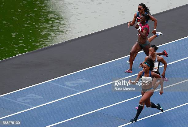 Rosangela dos Santos of Brazil runs against Carmelita Jeter of the United States Cleo Tyson Van Buren of the United States and Kauiza Venancio of...