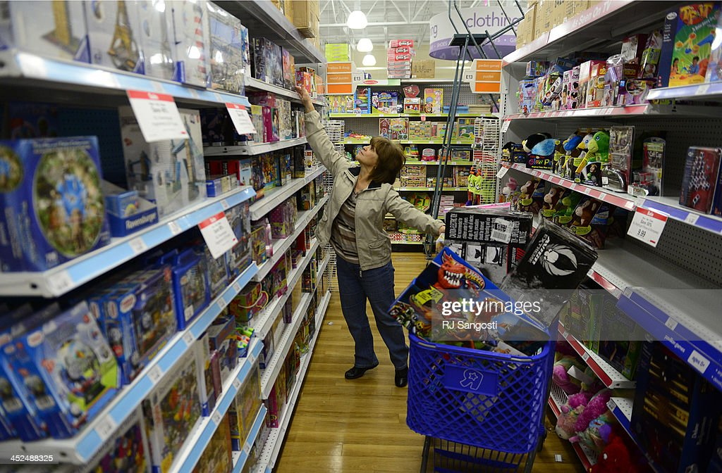 Rosann Sersante has a cart full of toys as she shops at a Toys'R'Us in Littleton, November 29, 2013. At 6 A.M. Sersante was one of only six customers in the Toys'R'Us shopping on Black Friday. With many stores opening on Thanksgiving crowds were lighter then normal for Black Friday.