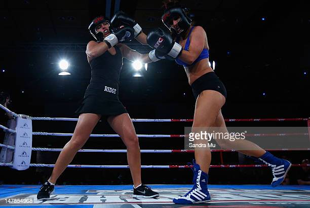 Rosanna Arkle punches Jaime Ridge during their boxing bout at Sky City Convention Centre on July 5 2012 in Auckland New Zealand