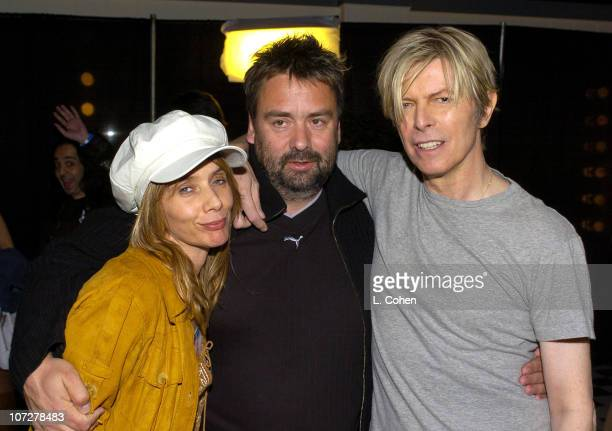 Rosanna Arquette Luc Besson and David Bowie during David Bowie's 'A Reality Tour' Backstage at Greek Theatre in Los Angeles California United States