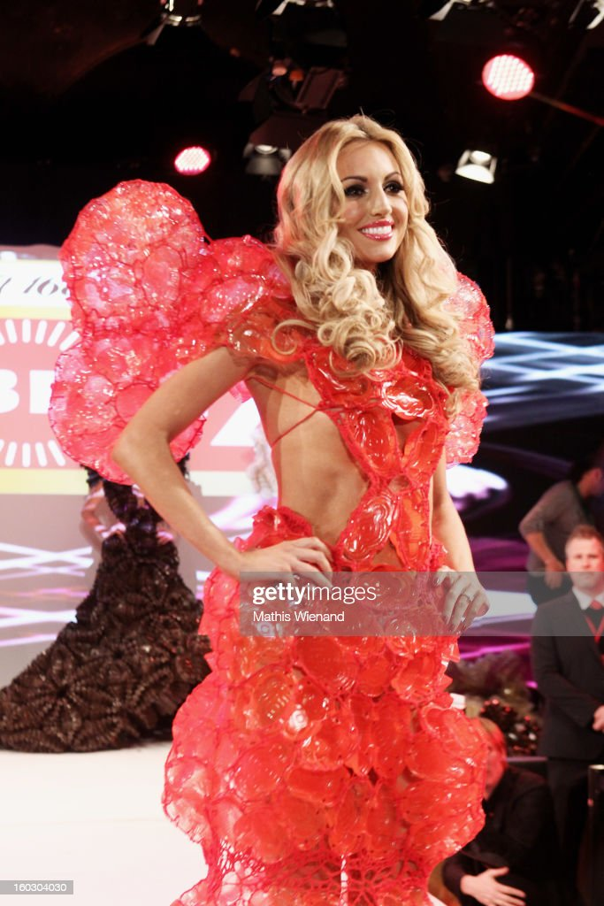 Rosanna Davison wearing creations out of Cake packagins by artist Larisa Katz Art couture walks the catwalk during the Lambertz Monday Night at Alter Wartesaal on January 28, 2013 in Cologne, Germany.