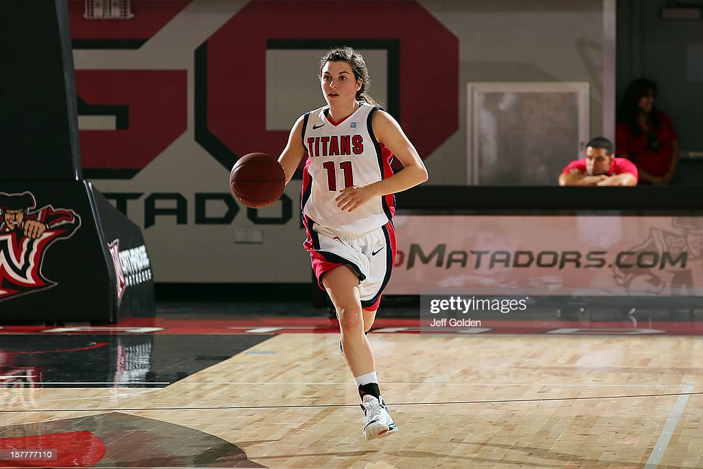 Rosanna Reynolds #11 of the Detroit Titans dribbles against the South Alabama Jaguars at The Matadome on November 24, 2012 in Northridge, California. South Alabama defeated Detroit 59-56.