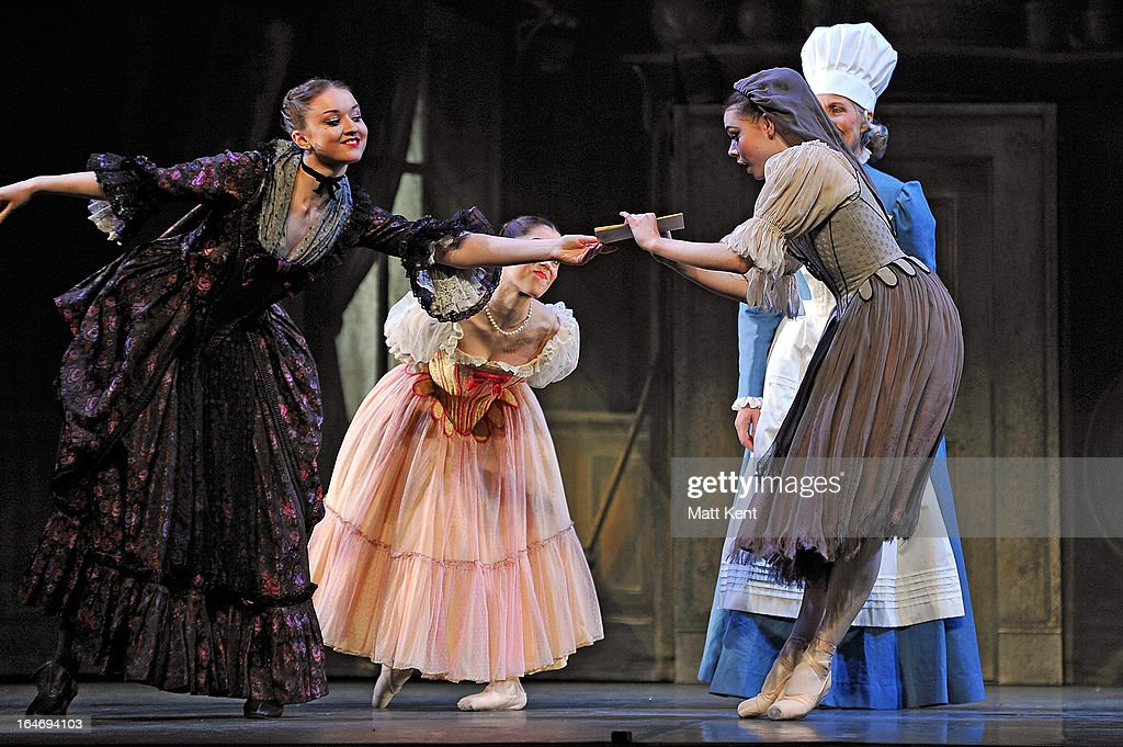 Rosanna Whittle as the step mother, Alanze Lopez Extebarria as one of the step sisters and Daniela Oddi as Cinderella perform during the dress rehearsal for the English National Ballet's 'My First Cinderella' at The Peacock Theatre on March 26, 2013 in London, England.