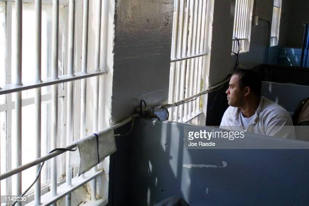 Rosario Claudio in prison for selling drugs spends a quiet moment between bible classes at the minimumsecurity facility known as the Carol Vance Unit...