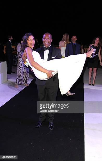 Rosario Dawson and Dennis dancing at the Porsche At De Grisogono 'Fatale In Cannes' Party during the 67th Cannes Film Festival on May 20 2014 in...