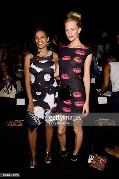 Rosario Dawson and Poppy Delevingne attend the Desigual fashion show during MercedesBenz Fashion Week Spring 2015 at The Theatre at Lincoln Center on...