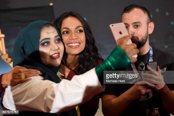 Rosario Dawson poses with fans onstage during the Artemis panel at the 2017 New York Comic Con Day 1 on October 5 2017 in New York City