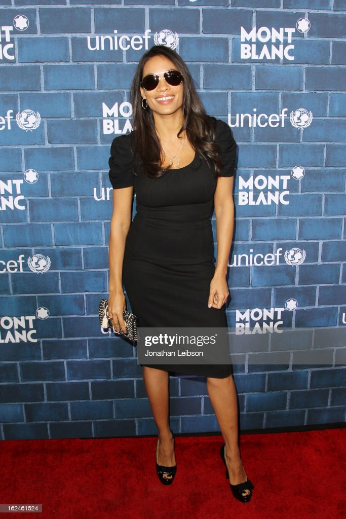 Rosario Dawson wearing Montblanc Star 4810 in Yellow Gold attends a Pre-Oscar charity brunch hosted by Montblanc and UNICEF to celebrate the launch of their new 'Signature For Good 2013' Initiative with special guest Hilary Swank at Hotel Bel-Air on February 23, 2013 in Los Angeles, California.