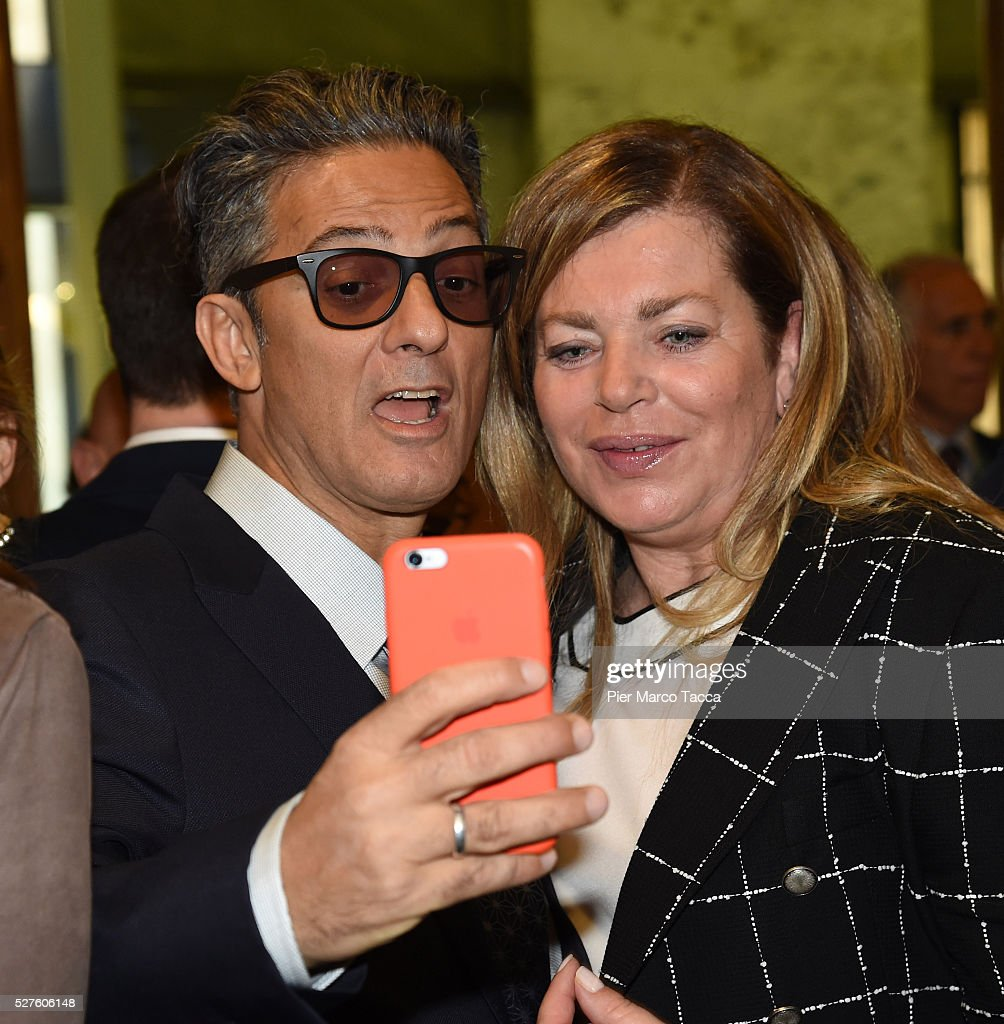 <a gi-track='captionPersonalityLinkClicked' href=/galleries/search?phrase=Rosario+Fiorello&family=editorial&specificpeople=2082907 ng-click='$event.stopPropagation()'>Rosario Fiorello</a> and Stefania Alessandri attend the Technogym Listing Ceremony at Palazzo Mezzanotte on May 3, 2016 in Milan, Italy. Technogym is the world leader in the construction of equipment for gyms, founded in 1983 by Nerio Alessandri, and was listed today on the Milan Stock Exchange.