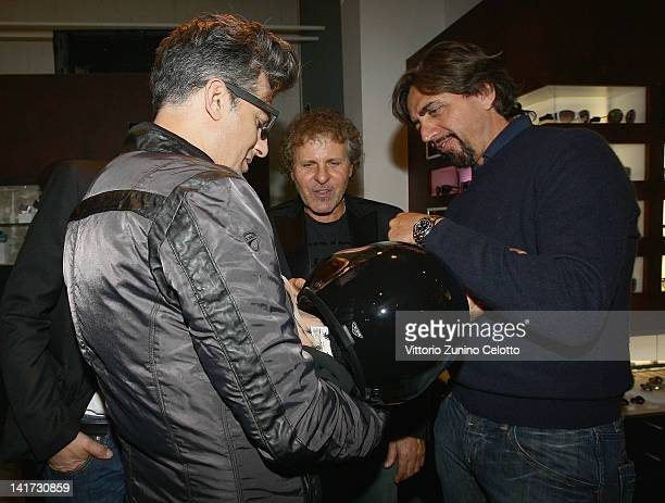 Rosario Fiorello Renzo Rosso and Valerio Staffelli attend the 'Diesel Together With Ducati' cocktail party on March 22 2012 in Rome Italy