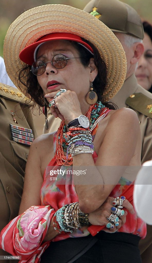 Rosario Murillo, wife of Nicaragua's President Daniel Ortega, gestures on July 26, 2013, during celebrations of the 60th Anniversary of Moncada barrack attack in Santiago de Cuba. Cuba on Friday launched 60th anniversary celebrations of ex-leader Fidel Castro's Moncada Barracks assault -- widely seen as the start to the country's communist revolution. The events, led by current President Raul Castro, kicked off in the courtyard of the former Moncada Garrison, where in 1953, a young Fidel Castro and more than 100 rebels attempted to overthrow the dictator Fulgencio Batista. The bid was unsuccessful, but Castro eventually toppled Batista in 1959, launching the Americas' only communist regime, which he ruled for five decades before stepping aside for health reasons in favour of his brother. At left, Nicaraguan President Daniel Ortega.