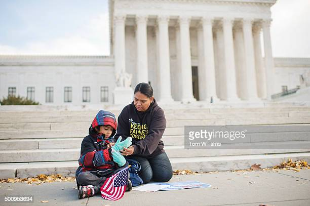 Rosario Reyes originally from El Salvador and her son Victor prepare for a news conference in front the Supreme Court to note the importance of the...